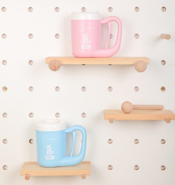 Automatic Paw Cleaning Cup on display in blue and pink